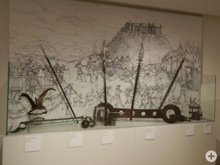 Folterwerkzeuge und Waffen